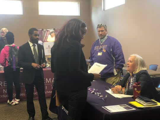 DJ Watson, the recruiter for graduate programs at Bethel University, talks with students during an Education Preparation Program fair at Lane College on Friday. Lane College students interested in becoming teachers learned of ways they can teach while pursuing their license and taking necessary coursework.