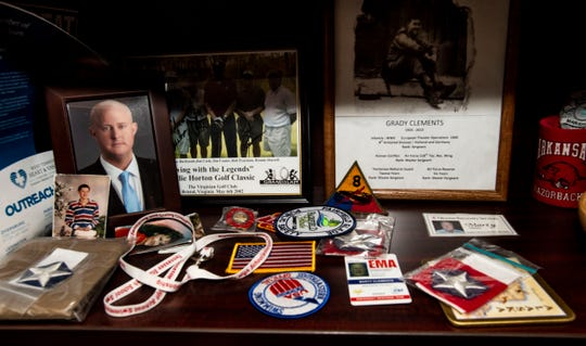 Director Marty Clements displaces knickknacks from his time in Brazil, photos of his family and friends and badges he's received during his time with the Jackson-Madison County Emergency Management Agency.