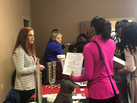 Jill Lofton, director of marketing and recruitment for Union University's School of Education, talks with Lane College students about the Education Preparation Program during a fair Friday.