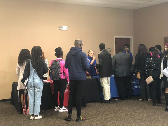 Students flock to the Union University and University of Memphis tables during an Education Preparation Program fair at Lane College on Friday.