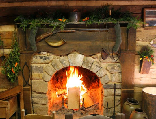 The Museum of Appalachia decorates its log buildings with traditional, simple decorations for the holiday season.