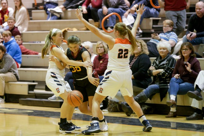 Harrison's Olivia Lowry (10) and Harrison's Sydney Jacobsen (22) guard McCutcheon's Ashley Griffith (30) and during the second quarter of game two in the 2019 Girls Hoops Classic, Monday, Nov. 18, 2019 in West Lafayette.