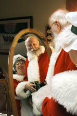 FILE PHOTO -- Roberta and Don Stoike as Santa and Mrs. Cluas in their home in Lafayette Monday November 15, 1999. Photo Illustration by Michael Heinz/Journal and Courier