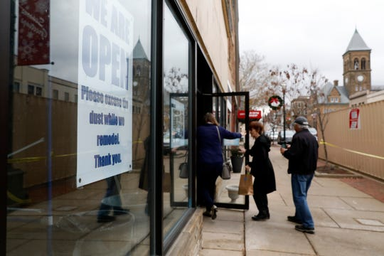 Customers walk into Four Reasons Bakery and Deli Tuesday afternoon, Nov. 19, 2019, in downtown Lancaster. The restaurant is being remodeled, but remains open during the process.