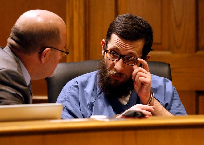 Daniel J. Campbell, right, adjusts his glasses as he speaks to his attorney Scott Wood Tuesday morning, Nov. 19, 2019, in Fairfield County Common Pleas Court in Lancaster. Campbell pleaded no contest to multiple counts of related to possessing child pornography. He was found guilty by Judge Richard Berens and will be sentenced at a later date.