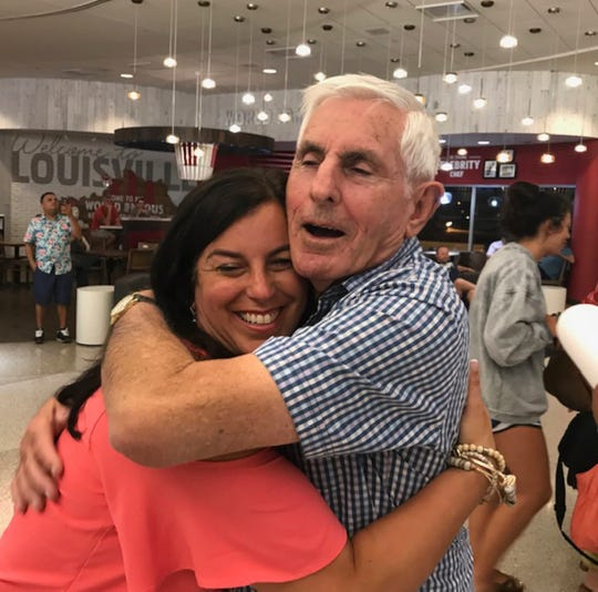 Nancy Galloway hugs her father, Alan Freedman, as he arrives at the airport in Louisville.  Freedman is from Australia.  Galloway only just recently found her father using a home DNA kit and a name that her mother shared with her just before her death.