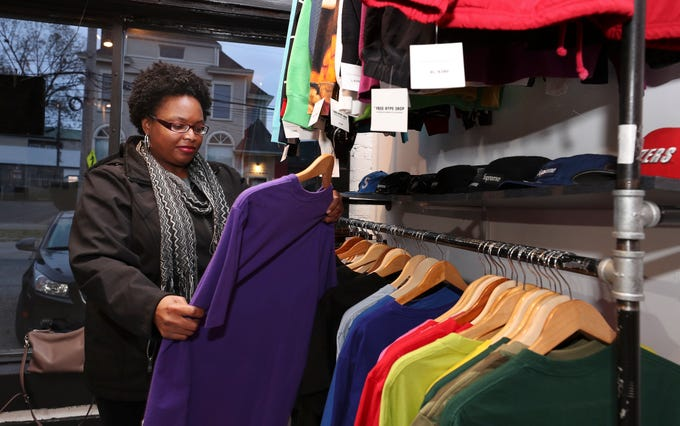 Sara Vaughn looks through clothing while Christmas shopping for her son at the Free Hype Shop which sells vintage apparel in Louisville, Ky. on Nov. 18, 2019.