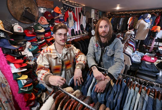 Max Whelan, left, and Josh Dunning are co-owners of Vintage Banana, which sells vintage apparel in Louisville.