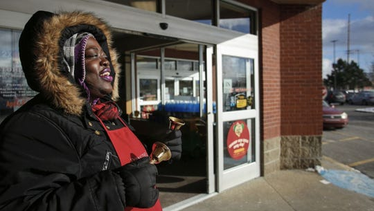 """Anna makes my day, she's always singing, she laughs a lot, and she always has a smile on her face,"" Ellen Lunden of Delta Township said after putting money in Salvation Army bell ringer Anna Diamond's kettle, Tuesday, Dec. 12, 2017. Diamond is one of the Lansing area's top collectors, and has become a sort of fixture at the Kroger on Lansing's west side during the holiday season."