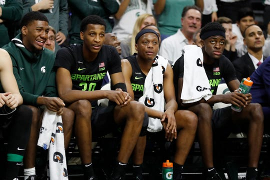 From left, Michigan State forwards Aaron Henry, Marcus Bingham Jr. (30), guard Cassius Winston and forward Gabe Brown watch during the second half of an NCAA college basketball game against Charleston Southern, Monday, Nov. 18, 2019, in East Lansing, Mich. (AP Photo/Carlos Osorio)