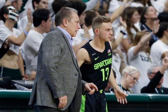 Michigan State head coach Tom Izzo sends his son guard Steven Izzo (13) into the game during the second half of an NCAA college basketball game against Charleston Southern, Monday, Nov. 18, 2019, in East Lansing, Mich. (AP Photo/Carlos Osorio)