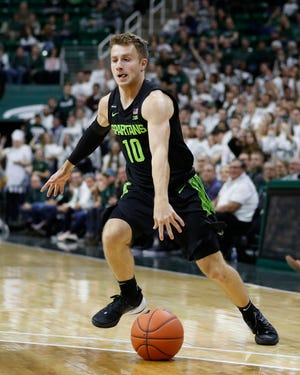 Michigan State guard Jack Hoiberg dribbles during the second half of an NCAA college basketball game against Charleston Southern, Monday, Nov. 18, 2019, in East Lansing, Mich. (AP Photo/Carlos Osorio)