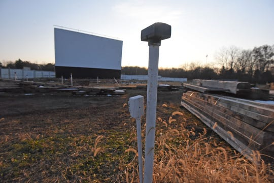 Individual car speakers from the former Sunset Drive-In will be replaced with reclaimed lumber from disassembled barns.