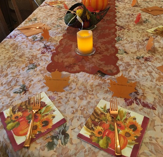 Jan Zauzmer is among three generations that will celebrate Thanksgiving around the dining room table in the East Memphis home where she grew up. The table holds 50 years of memories, and more will be added at Thanksgiving.
