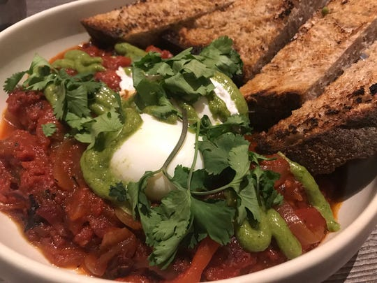 Shakshuka, poached eggs on roasted peppers and tomatoes, is on the menu at Ash, the new open-hearth restaurant in the Iron Horse Hotel in Walker's Point.