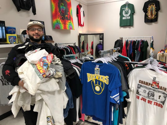 Acevedo sells all types of clothing, but he has a large amount of T-shirts for sale.