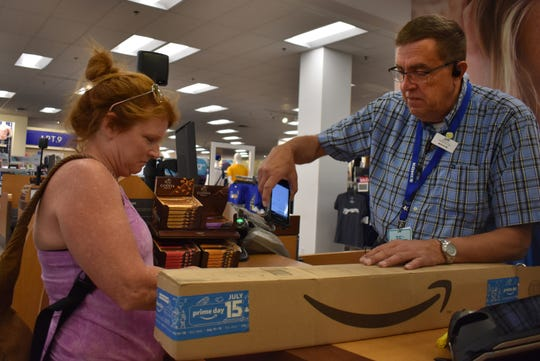 "Laura Wing returns an Amazon package before going to shop around the Brookfield Kohl's store this summer. Kohl's CEO Michelle Gass cited the Amazon returns program Tuesday, saying the company is at ""a very unique point."""