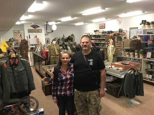 Owners of Military Connection in South Milwaukee (from left) Jeannie Luther and Craig Luther inside their shop. The shop carries military items from various eras and countries.