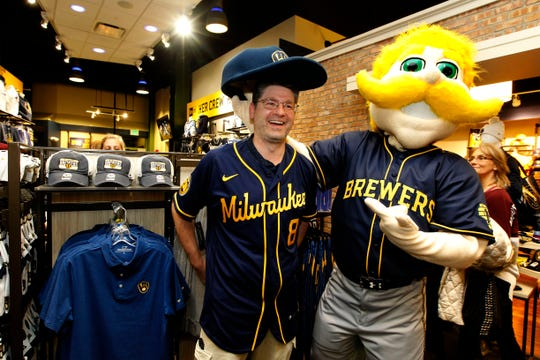 Jim Rosin of Janesville poses for a photo with the Bernie Brewer  while shopping at the Brewers Team Store on Monday. Rosin and several hundred fans were on hand to purchase the team's new uniforms that were unveiled at Miller Park.
