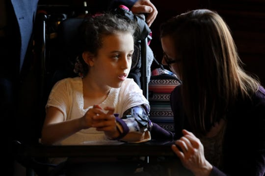 Norah Lowe, from Merrimac, Wis., who suffers from Rett syndrome, a neurological disorder, spoke using a computer after Rep. Melissa Sargent, D-Madison, announced plans to introduce a bill to fully legalize marijuana on April 18, 2019, in Madison, Wis. Sargent introduced the bill on May 17. Norah is seen with her mother Megan Lowe and father, Josh Lowe. In October, a bipartisan group of Wisconsin lawmakers proposed legalizing marijuana for medical use.