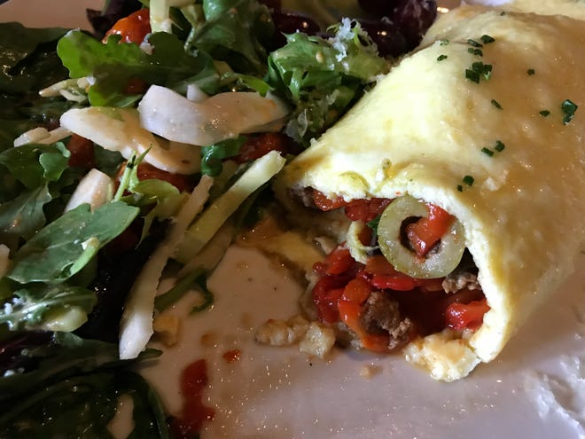 An omelet filled with roasted red pepper, chorizo and olives is one weekend option at Mistral, 2473 S. Kinnickinnic Ave. Brunch entrees come with salad or breakfast potatoes.