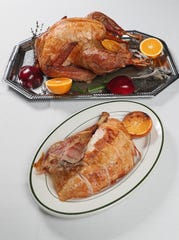 Roasting a whole turkey, as shown here prepared by Emerald City Catering, is still an easy way to serve a crowd and end up with leftovers.