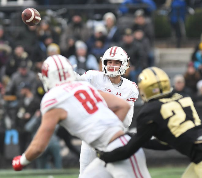 UW quarterback Jack Coan completed 16 of 24 passes for 160 yards and two touchdowns in the Badgers' 47-44 victory over Purdue in three overtimes last season.