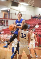Cotter's Tucker Coots goes to the basket as Bergman's Elijah Royce attempts to draw a charge on Monday at Flippin.