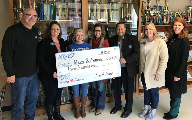 Cotterteacher Alexa Bateman was recently selected to receive a $500 grant from Arvest Bank as part of the We Heart Teachers campaign. The winning teachers will use their $500 awards toward enriching the classroom learning experience. The Arvest initiative to honor educators was launched on Oct. 7. Nominations were accepted via the Arvest Bank Facebook page. Pictured are: (from left) Airl Cheek, Cotter Elementary School Principal;Cindy Sutterfield, Arvest; Bateman; Vickie Crisenbery, Arvest;David McBee, Arvest; Stacie Goldsmith, Arvest; andJaren Beavers, Arvest.