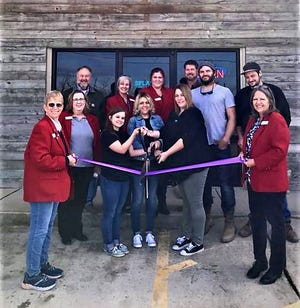 """The Mountain Home Area Chamber of Commerce recently held a ribbon cuttingfor Splash Pool and Spa to celebrate their new location in Mountain Home, 3225 Highway 62 E STE 3.Owner Jessica Trivitt says the name was changed to Splash Pool and Spa because a previous business, Splash's, closed its doors.""""We have dropped the 's'because we're not the same — we're better!""""Pictured are:Chamber red coat ambassadors, Jessica Trivitt, Tara Livingston, Sam Ainsworthand the repair team Josh Johnson and Dillon White. Splash serves Northern Arkansas and Southern Missouri. A $100 donation is given to a local charity of choice with a spa purchase.The company is committed to providing excellent service and ensuring the highest quality-built swimming pools and spas. The offer free water testing, pool and spa chemicals, in-ground fiberglass pools, above-ground pools, Hot Spring Spas and Healthmate Saunas.For more information visit splashmh.com or facebook.com/splashmh/."""