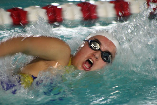 Mountain Home's Olivia Wham competes in the 400 freestyle relay on Monday at Paragould.