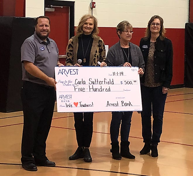 """Norfork teacher Carla Sutterfieldwas recently selected to receive a $500 grant from Arvest Bank as part of the We Heart Teachers campaign. The winning teachers will use their $500 awards toward enriching the classroom learning experience. The Arvest initiative to honor educators was launched on Oct. 7. Nominations were accepted via the Arvest Bank Facebook page. Pictured are: (from left)David McBee, Arvest; Sally Gilbert, Arvest,Sutterfield;and Dawn Cotter,Arvest.""""Teachers in every grade level have the tremendous responsibility to educate and inspire our children, so we are thrilled to be able to support their work in this way,"""" said Gilbert, market president of Arvest Bank in Mountain Home."""