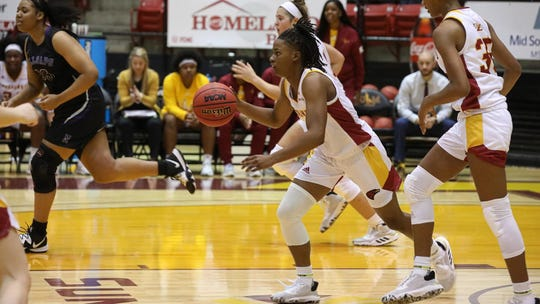 Amber Thompson (1) finished with eight points in ULM's 63-54 win over Northwestern State on Monday night a Fant-Ewing Coliseum. Lauren Fitch led the Warhawks with 15 points.