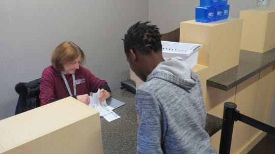 Malachi Stevens, 14, a special-needs student from Bloomfield, visits the bank at LifeTown, where 53,000 square feet of commercial space off Route 10 has been transformed into a special village, where special-needs kids can learn and practice essential life skills in an environment designed just for them. November 19, 2019.