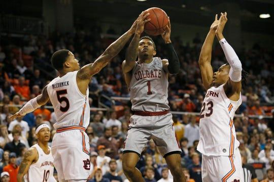Auburn guard J'Von McCormick blocks a shot from Colgate's Jordan Burns on Nov. 18, 2019.
