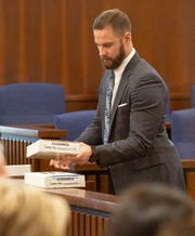 Prosecutor Ben McGough pulls evidence out ahead of opening arguments in the murder trial for officer A.C. Smith.