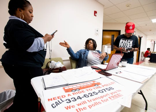 Kynesha Brown, center, takes calls and dispatches drivers to drive voters to the polls as part of the Rollin to the Polls initiative during the mayoral runoff election in Montgomery, Ala., on Tuesday October 8, 2019.