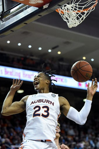 Auburn forward Isaac Okoro (23) celebrates a dunk against Colgate during the second half of an NCAA college basketball game Monday, Nov. 18, 2019, in Auburn, Ala. (AP Photo/Julie Bennett)