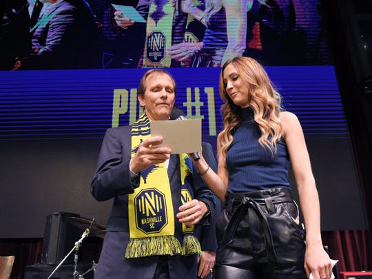 Nashville SC owner John Ingram announces the first pick during the MLS expansion draft at Ole Red on Broadway in Nashville on Nov. 19, 2019.