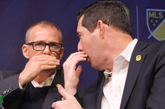 Nashville Soccer Club head coach Gary Smith and General Manager Mike Jacobs talk during MLS expansion draft night at a draft party at Ole Red on Broadway in Nashville on Tuesday, Nov.19, 2019.