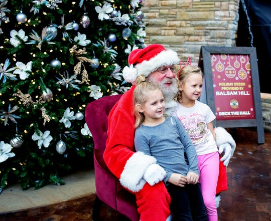 A past Ford Day Santa Claus with a couple of kids at the Country Music Hall of Fame and Museum.