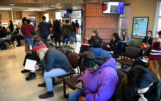 Citizens read books or look at their phones as they wait their turn at the Nashville/Hart Lane Driver Services Center Monday, Nov. 18, 2019, in Nashville, Tenn.