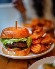 A burger and Old Bay seasoned fries from Mother's Ruin, opening soon in Germantown.