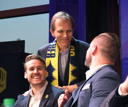 Nashville Soccer Club owner John Ingram announces the first pick during MLS expansion draft at Ole Red on Broadway in  Nashville on Tuesday, Nov.19, 2019.