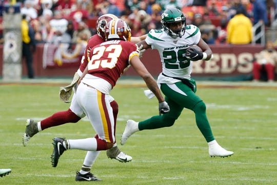 Nov 17, 2019; Landover, MD, USA; New York Jets running back Bilal Powell (29) carries the ball as Washington Redskins cornerback Quinton Dunbar (23) chases in the third quarter at FedExField.
