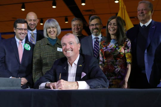 Gov. Phil Murphy is shown just before signing an executive order to increase New Jersey's offshore wind-generated electricity from 3,500 megawatts by 2030 to 7,500 megawatts by 2035. New Jersey plans to have 50% renewable energy by 2030 and 100% by 2050. Tuesday, November 19, 2019