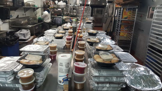 Thanksgiving dinner is all packed and ready for those who ordered them at Vesta Wood Fired in East Rutherford.