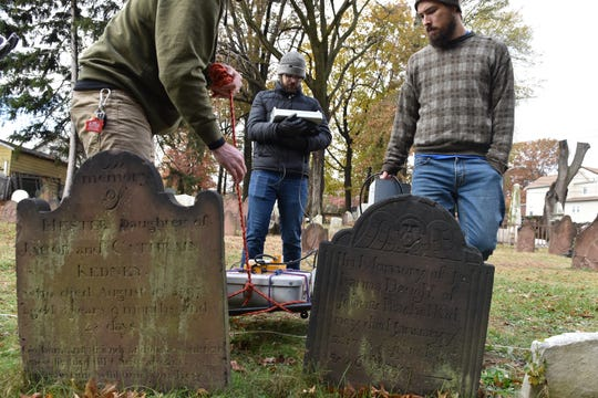 Students of a Geophysics Master's Class at Rutgers University Newark are searching for lost graves at the Dutch Reformed Church in Belleville, N.J. on Tuesday Nov. 19, 2019. They are searching for graves and remains from the American Revolution and some of the first Chinese immigrants to the United States.