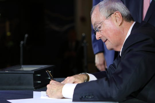 Gov. Phil Murphy is shown as he signs an executive order to increase New Jersey's offshore wind-generated electricity from 3,500 megawatts by 2030 to 7,500 megawatts by 2035. New Jersey plans to have 50% renewable energy by 2030 and 100% by 2050. Tuesday, November 19, 2019
