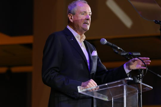 Gov. Murphy, is shown at Liberty Science Center, in Jersey City, before signing an executive order to increase New Jersey's offshore wind-generated electricity from 3,500 megawatts by 2030 to 7,500 megawatts by 2035. New Jersey plans to have 50% renewable energy by 2030 and 100% by 2050. Tuesday, November 19, 2019